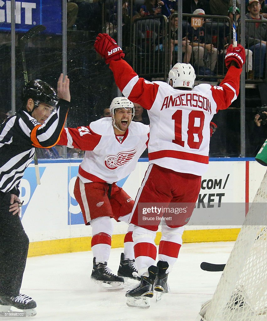 Luke Glendening and Joakim Andersson of the Detroit Red Wings celebrate a first period goal that was later disallowed against the New York Rangers at...