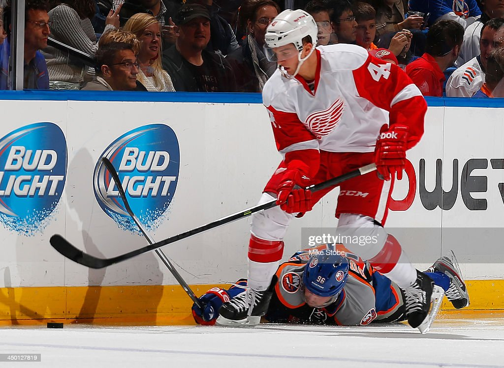 <a gi-track='captionPersonalityLinkClicked' href=/galleries/search?phrase=Luke+Glendening&family=editorial&specificpeople=5650380 ng-click='$event.stopPropagation()'>Luke Glendening</a> #41 of Detroit Red Wings and Pierre-Marc Bouchard #96 of the New York Islanders battle for the puck at Nassau Veterans Memorial Coliseum on November 16, 2013 in Uniondale, New York. Islanders defeated the Red Wings 5-4 in a shootout.