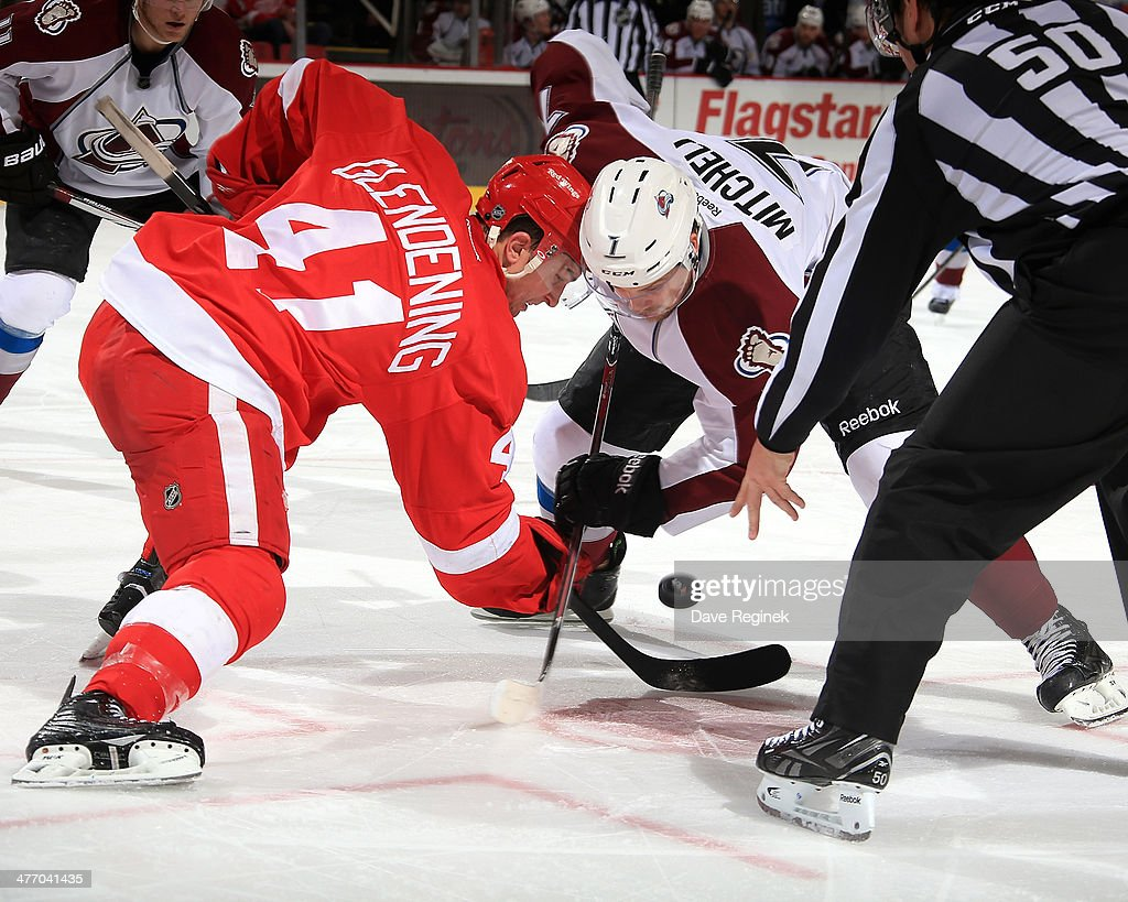 <a gi-track='captionPersonalityLinkClicked' href=/galleries/search?phrase=Luke+Glendening&family=editorial&specificpeople=5650380 ng-click='$event.stopPropagation()'>Luke Glendening</a> #41 of the Detroit Red Wings and John Mitchell #7 of the Colorado Avalanche face off during an NHL game on March 6, 2014 at Joe Louis Arena in Detroit, Michigan.