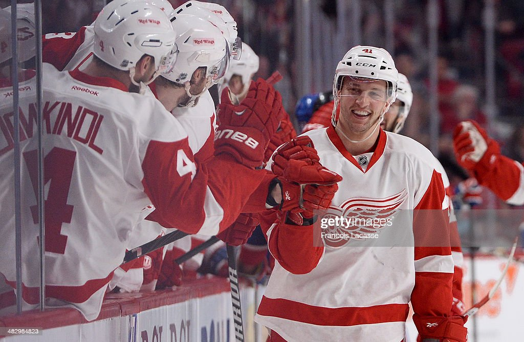 <a gi-track='captionPersonalityLinkClicked' href=/galleries/search?phrase=Luke+Glendening&family=editorial&specificpeople=5650380 ng-click='$event.stopPropagation()'>Luke Glendening</a> #41 of the Detroit Red Wings celebrates after scoring a goal against the Montreal Canadiens during the NHL game on April 5, 2014 at the Bell Centre in Montreal, Quebec, Canada.