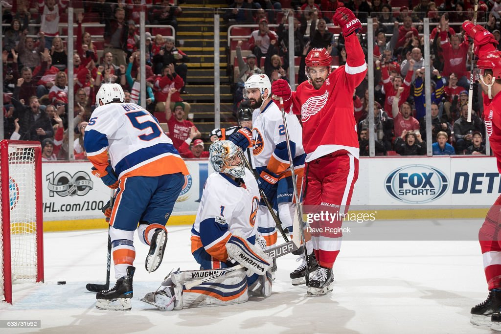 Luke Glendening #41 of the Detroit Red Wings scores a first period goal as teammate Riley Sheahan #15 celebrates in front of goaltender Thomas Greiss #1, Johnny Boychuk #55 and Nick Leddy #2 of the New York Islanders during an NHL game at Joe Louis Arena on February 3, 2017 in Detroit, Michigan.