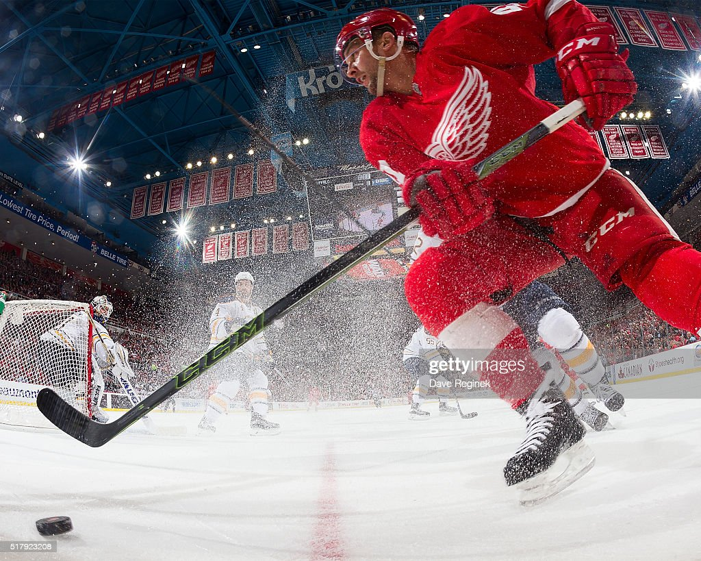 Luke Glendening #41 of the Detroit Red Wings skates with the puck behind the net during an NHL game against the Buffalo Sabres at Joe Louis Arena on March 28, 2016 in Detroit, Michigan.