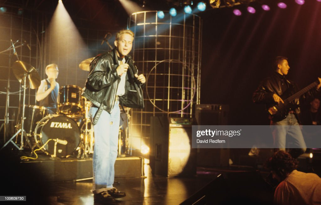 Luke Goss Matt Goss and Craig Logan of Bros perform on stage circa 1988
