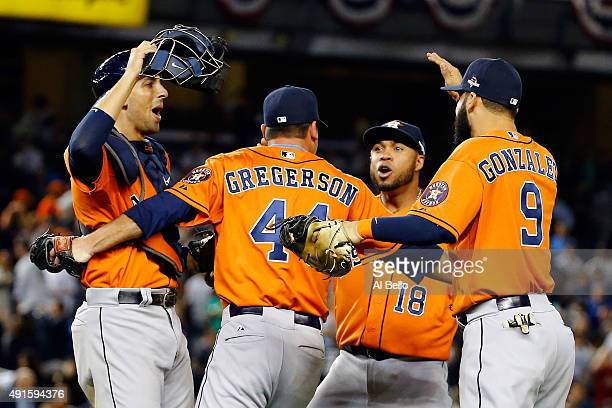Luke Gregerson of the Houston Astros celebrates with his teammates Jason Castro Luis Valbuena and Marwin Gonzalez after defeating the New York...