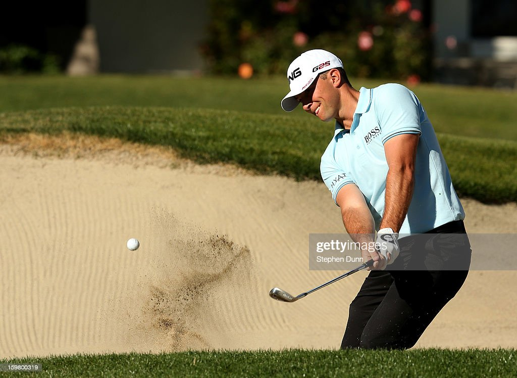 Luke Guthrie hits out of a bunker during the final round of the Humana Challenge In Partnership With The Clinton Foundation on the Palmer Private Course at PGA West on January 20, 2013 in La Quinta, California.