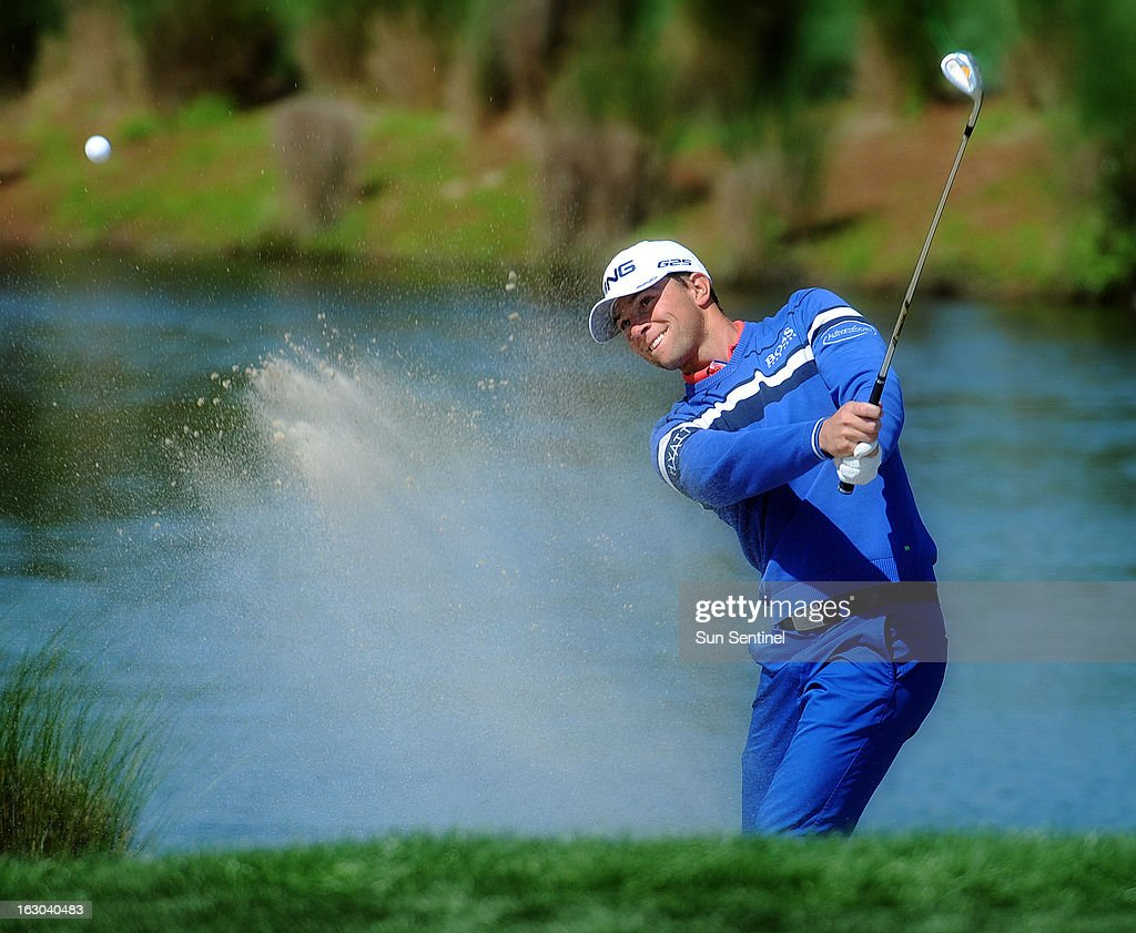 Luke Guthrie hits out of a greenside bunker on the third hole, while playing with the eventual winner, Michael Thompson, during the final round of the Honda Classic at the PGA National Resort and Spa in Palm Beach Gardens, Florida, Sunday, March 3, 2013.