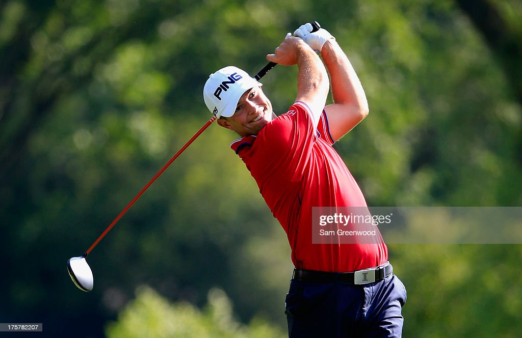 Luke Guthrie of the United States hits his tee shot on the ninth hole during the first round of the 95th PGA Championship on August 8, 2013 in Rochester, New York.