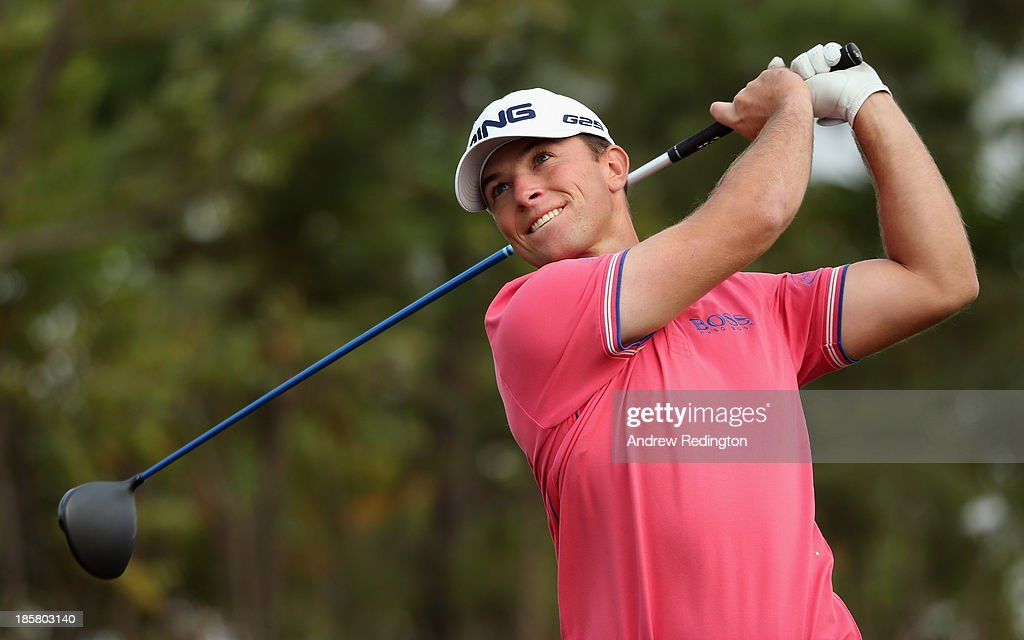 Luke Guthrie of the USA hits his tee-shot on the 16th hole during the second round of the BMW Masters at Lake Malaren Golf Club on October 25, 2013 in Shanghai, China.