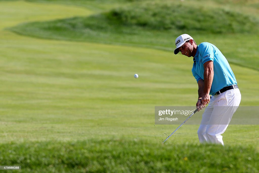 Luke Guthrie plays a shot on the 18th hole during the second round of the Travelers Championship at TPC River Highlands on June 26, 2015 in Cromwell, Connecticut.