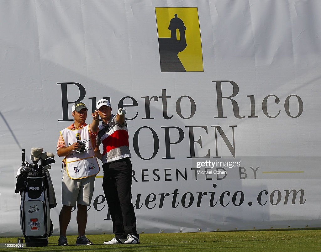 Luke Guthrie (R) prepares to play on the 14th tee box during the first round of the Puerto Rico Open presented by seepuertorico.com held at Trump International Golf Club on March 7, 2013 in Rio Grande, Puerto Rico.