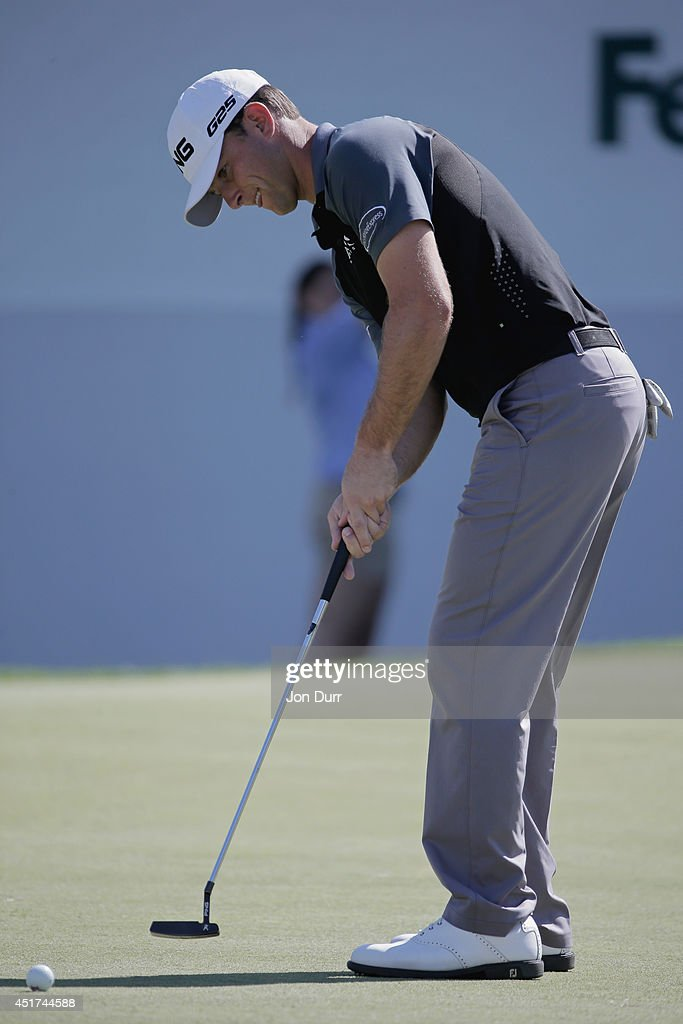 Luke Guthrie putts on the 18th green during the third round of the Greenbrier Classic at the Old White TPC on July 5, 2014 in White Sulphur Springs, West Virginia.