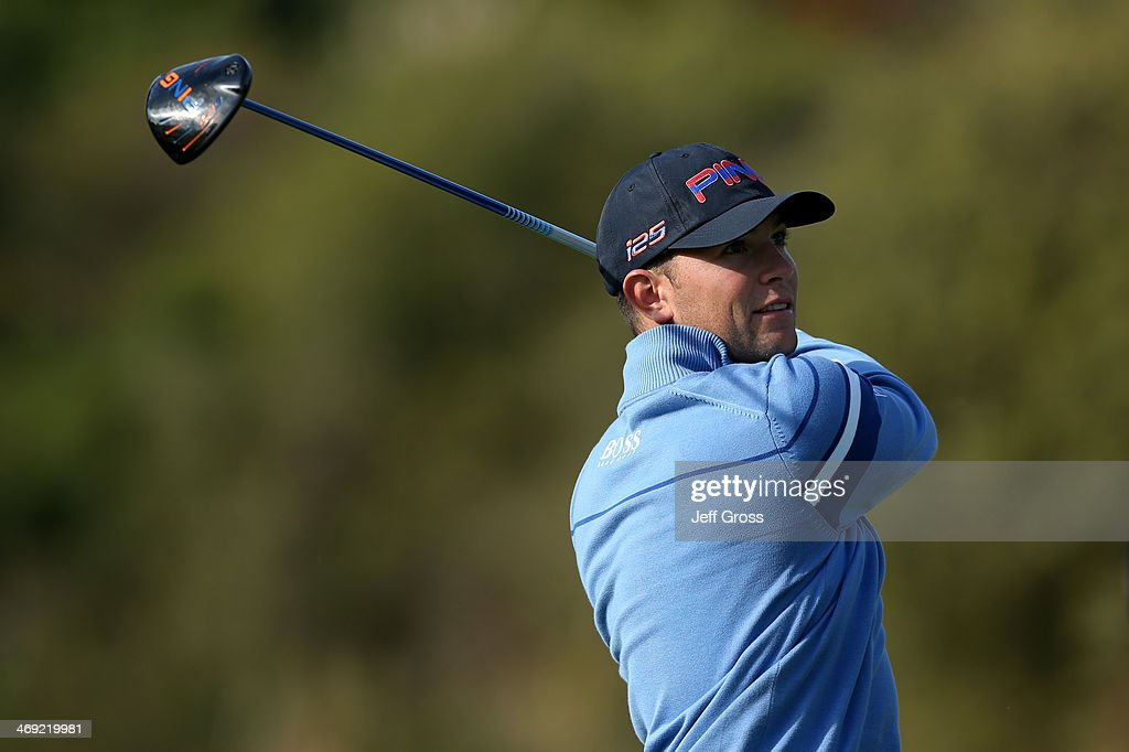 Luke Guthrie watches his shot in the first round of the Northern Trust Open at the Riviera Country Club on February 13, 2014 in Pacific Palisades, California.