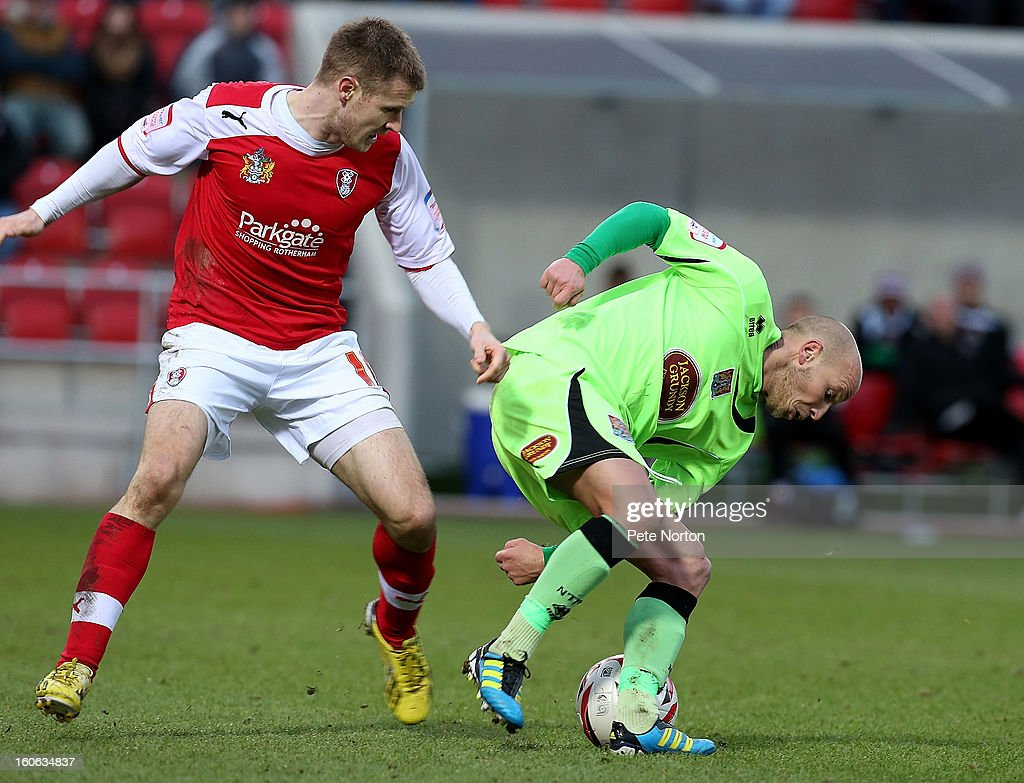 Luke Guttridge (R) of Northampton Town attempts to control the ball watched by Michael O'Connor of Rotherham United during the npower League Two match between Rotherham United and Northampton Town at New York Stadium on February 2, 2013 in Rotherham, England.