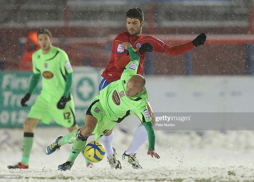 Luke Guttridge of Northampton Town attempts to control the ball under pressure from Dani Lopez of Aldershot Town during the npower League Two match between Aldershot Town and Northampton Town at the EBB Stadium on January 22, 2013 in Aldershot, England.