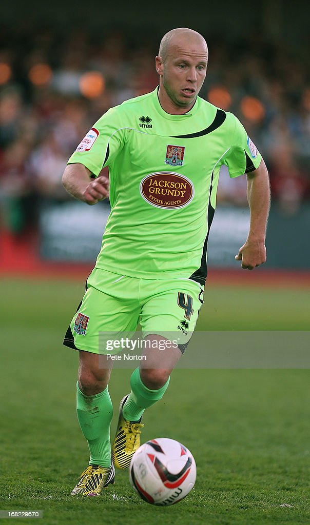 Luke Guttridge of Northampton Town in action during the npower League Two Play Off Semi Final Second Leg between Cheltenham Town and Northampton Town at Abbey Business Stadium on May 5, 2013 in Cheltenham, England.