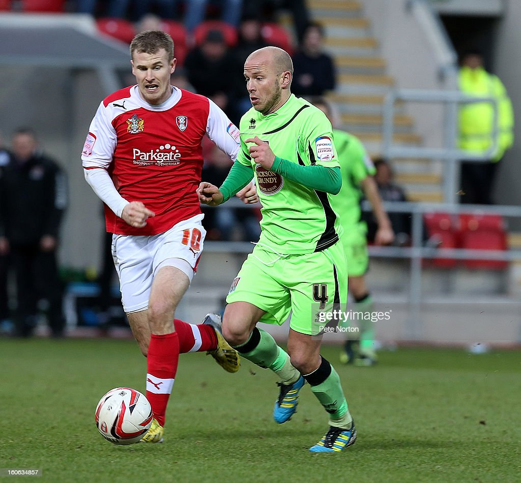 Luke Guttridge (R) of Northampton Town moves forward with the ball watched by Michael O'Connor of Rotherham United during the npower League Two match between Rotherham United and Northampton Town at New York Stadium on February 2, 2013 in Rotherham, England.