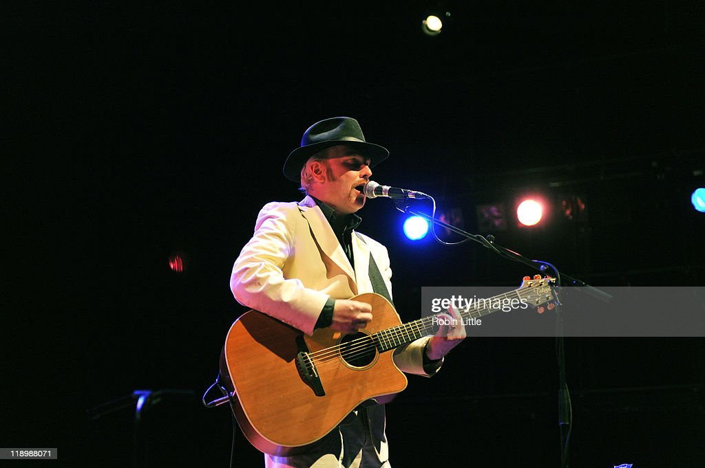 Luke Haines performs on stage at the Queen Elizabeth Hall on July 13, 2011 in London, United Kingdom.