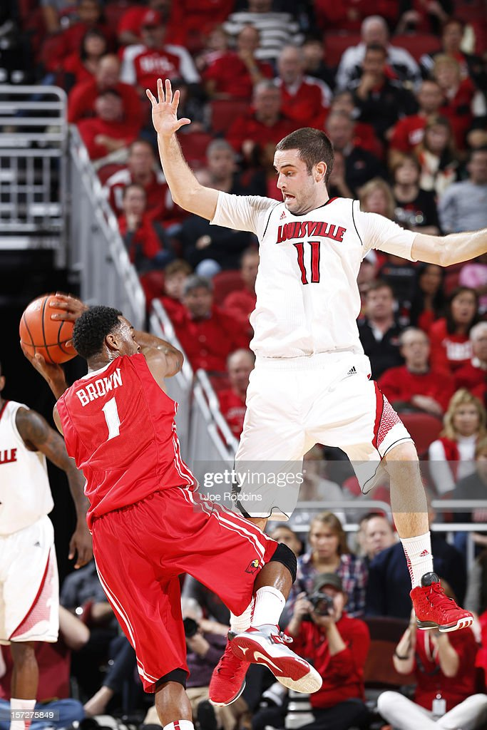 Luke Hancock #11 of the Louisville Cardinals defends against Tyler Brown #1 of the Illinois State Redbirds during the game at KFC Yum! Center on December 1, 2012 in Louisville, Kentucky. Louisville won 69-66.