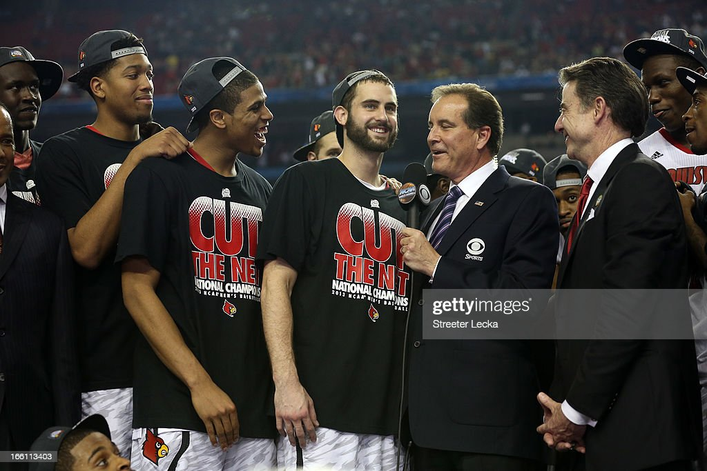 Luke Hancock #11 (C) of the Louisville Cardinals is interviewed by CBS announcer Jim Nantz as he celebrates with teammates after they won 82-76 against the Michigan Wolverines during the 2013 NCAA Men's Final Four Championship at the Georgia Dome on April 8, 2013 in Atlanta, Georgia.