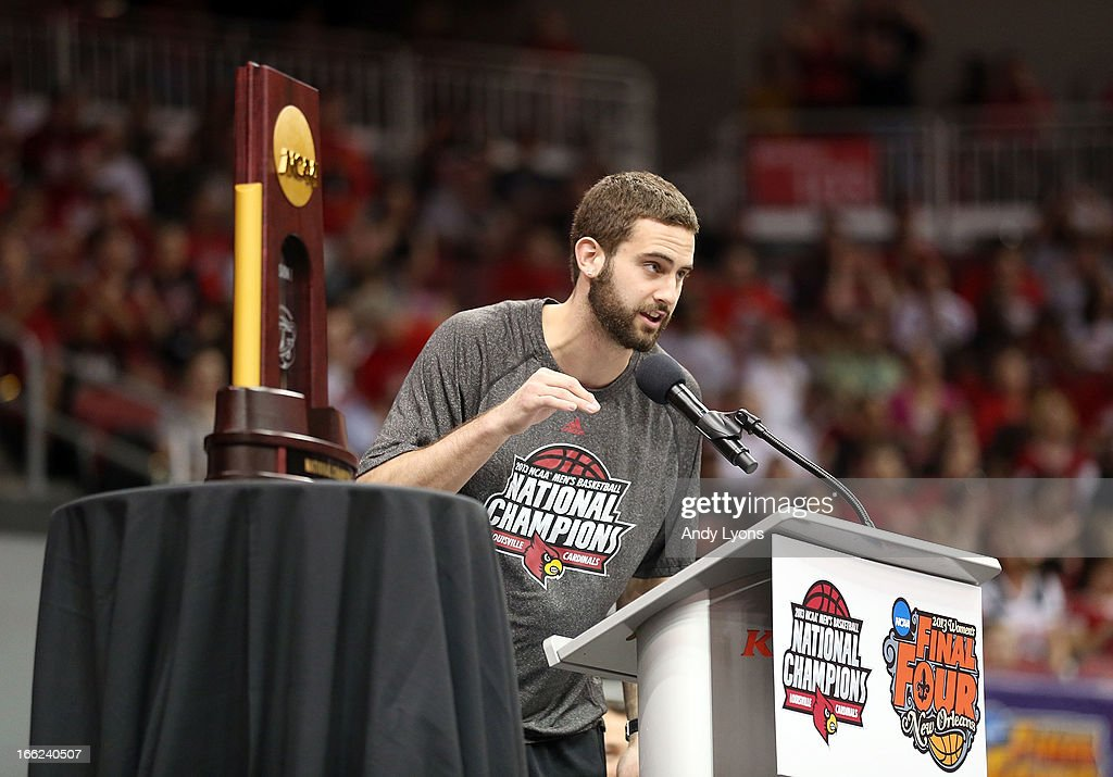 Luke Hancock of the Louisville Cardinals talks during the Louisville Cardinals NCAA Basketball Celebration to mark the NCAA championship by the Mens team and the runner-up finish by the womens team at KFC YUM! Center on April 10, 2013 in Louisville, Kentucky.