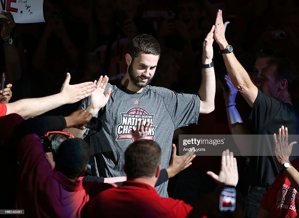 Luke Hancock of the Louisville Cardinals walks thru the crowd during the Louisville Cardinals NCAA Basketball Celebration to mark the NCAA championship by the Mens team and the runner-up finish by the womens team at KFC YUM! Center on April 10, 2013 in Louisville, Kentucky.
