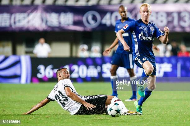 Luke Hemmerich of FC Schalke 04 and Cenk Tosun of Besiktas comepte for the ball during the 2017 International soccer match between Schalke 04 and...