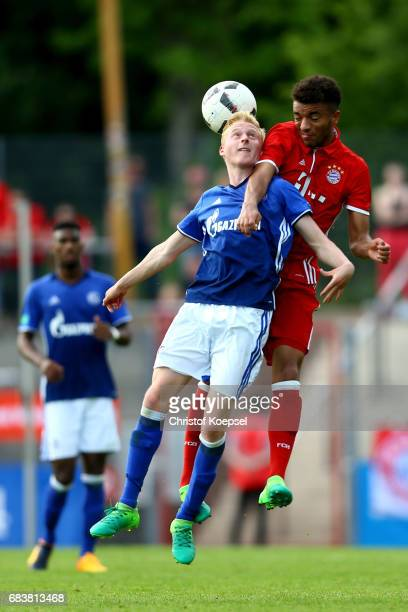 Luke Hemmerich of Schalke and Timothy Tillmann of Bayern go up for a header during the U19 German Championship Semi Final second leg match between FC...