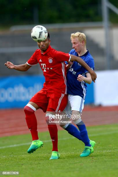 Luke Hemmerich of Schalke challenges Timothy Tillmann of Bayern during the U19 German Championship Semi Final second leg match between FC Schalke and...
