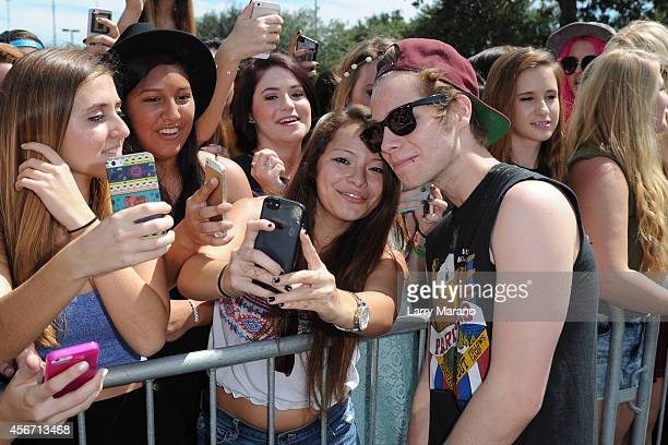 Luke Hemmings of 5 Seconds of Summer greets fans after a private show at radio station Y100 on October 5 2014 in Miami Florida