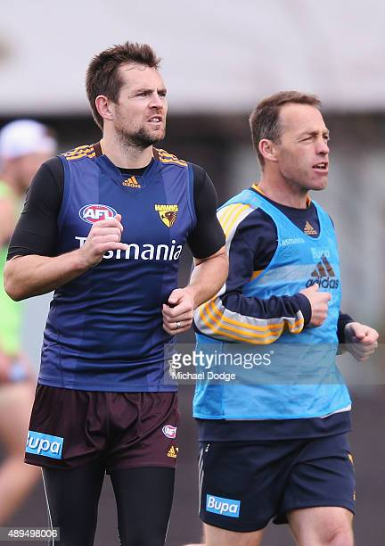 Luke Hodge and Hawks head coach Alastair Clarkson shout and gesture during a Hawthorn Hawks AFL training session at Waverley Park on September 22...