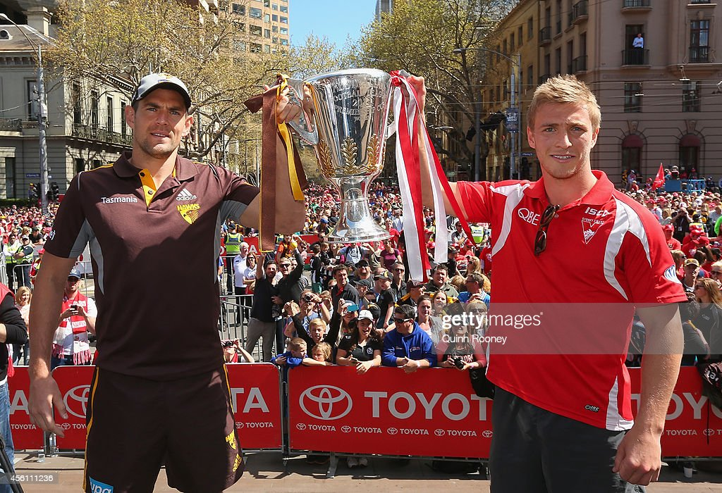 Luke Hodge of the hawks and Kieren Jack of the swans hold up the Premiership Cup during the 2014 AFL Grand Final Parade on September 26 2014 in...