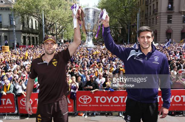 Luke Hodge of the Hawks and Matthew Pavlich of the Dockers pose with the Premiership Cup during the 2013 AFL Grand Final Parade on September 27 2013...