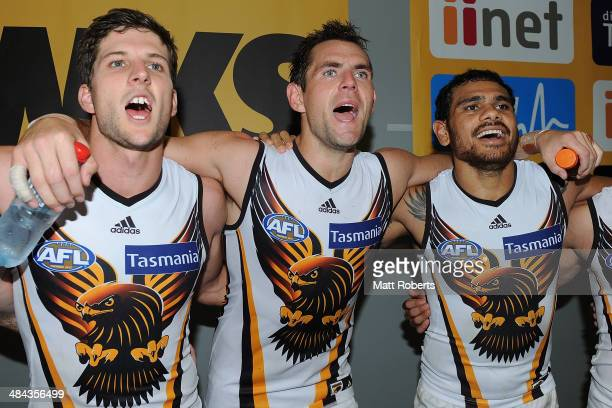 Luke Hodge of the Hawks celebrates with teammates after the round four AFL match between the Gold Coast Suns and the Hawthorn Hawks at Metricon...