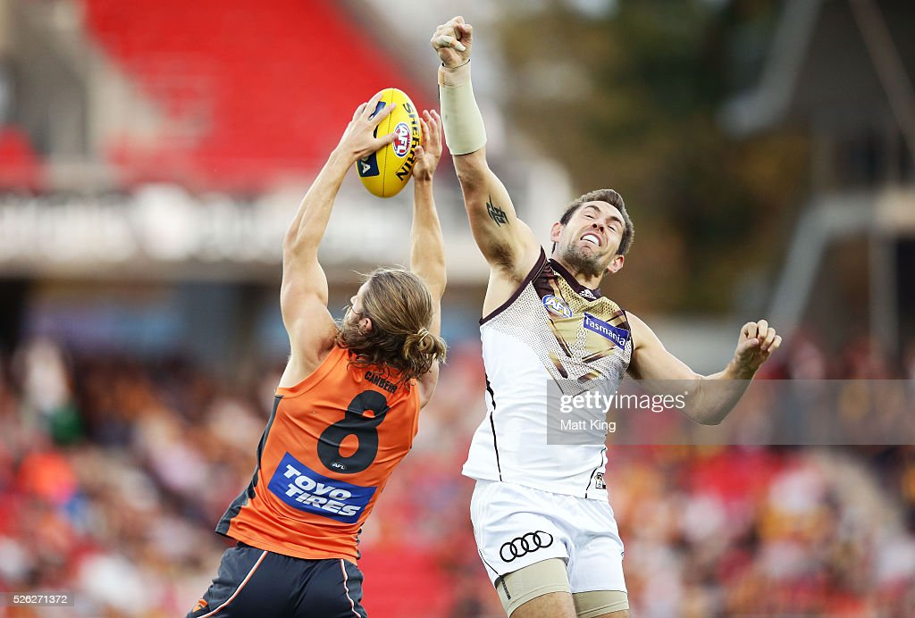 <a gi-track='captionPersonalityLinkClicked' href=/galleries/search?phrase=Luke+Hodge&family=editorial&specificpeople=241521 ng-click='$event.stopPropagation()'>Luke Hodge</a> of the Hawks defends against Callan Ward of the Giants during the round six AFL match between the Greater Western Sydney Giants and the Hawthorn Hawks at Spotless Stadium on April 30, 2016 in Sydney, Australia.
