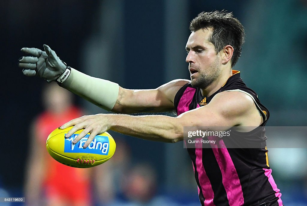 <a gi-track='captionPersonalityLinkClicked' href=/galleries/search?phrase=Luke+Hodge&family=editorial&specificpeople=241521 ng-click='$event.stopPropagation()'>Luke Hodge</a> of the Hawks kicks during the round 14 AFL match between the Hawthorn Hawks and the Gold Coast Suns at Aurora Stadium on June 26, 2016 in Launceston, Australia.