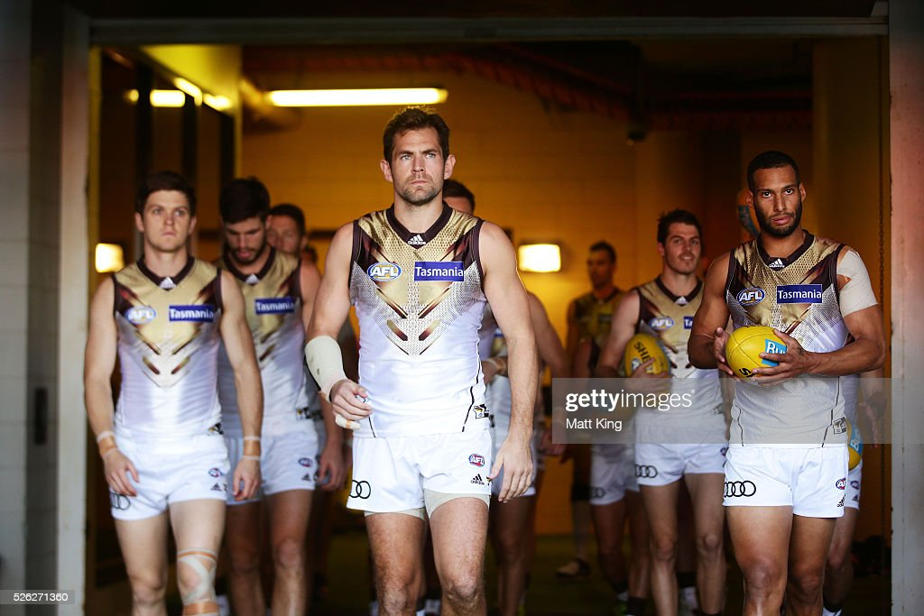 <a gi-track='captionPersonalityLinkClicked' href=/galleries/search?phrase=Luke+Hodge&family=editorial&specificpeople=241521 ng-click='$event.stopPropagation()'>Luke Hodge</a> of the Hawks leads out the Hawks during the round six AFL match between the Greater Western Sydney Giants and the Hawthorn Hawks at Spotless Stadium on April 30, 2016 in Sydney, Australia.