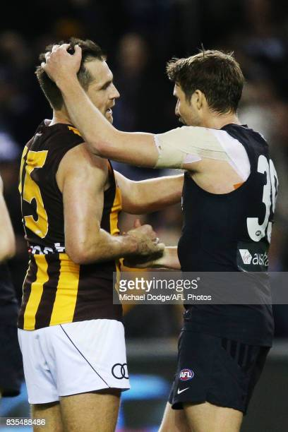 Luke Hodge of the Hawks looks dejected ater defeat with Dale Thomas of the Blues during the round 22 AFL match between the Carlton Blues and the...