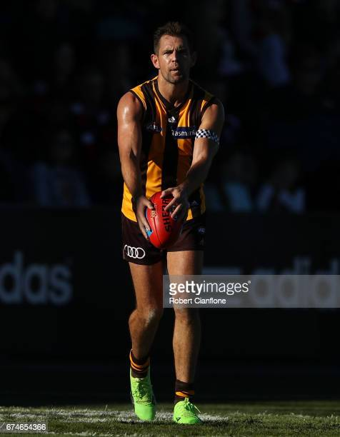 Luke Hodge of the Hawks looks to kick the ball during the round six AFL match between the Hawthorn Hawks and the St Kilda Saints at University of...