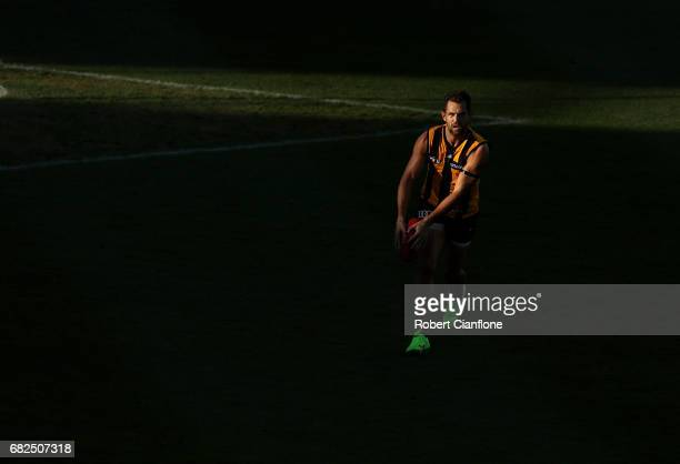 Luke Hodge of the Hawks runs with the ball during the round eight AFL match between the Hawthorn Hawks and the Brisbane Lions at University of...