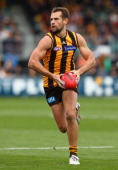 Luke Hodge of the Hawks runs with the ball during the round four AFL match between the Hawthorn Hawks and the Fremantle Dockers at Aurora Stadium on...