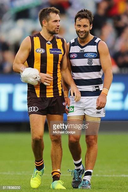 Luke Hodge of the Hawks talking to Jimmy Bartel of the Cats walks off after defeat with ice strapped to his arm during the round one AFL match...