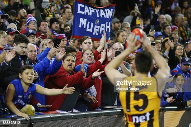 Luke Hodge of the Hawks thanks Bulldogs fans after his retirement during round 23 AFL match between the Hawthorn Hawks and the Western Bulldogs at...