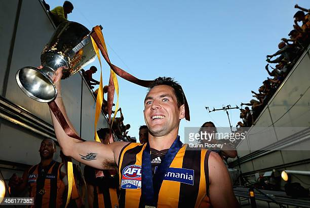 Luke Hodge of the Hawks walks off the field with the Premeirship Cup during the 2014 AFL Grand Final match between the Sydney Swans and the Hawthorn...