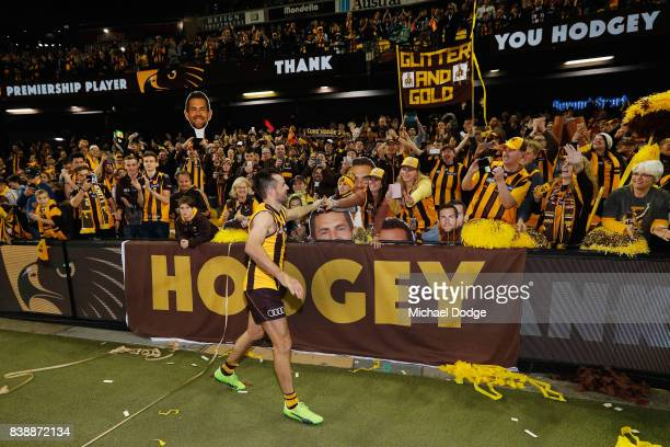 Luke Hodge of the Hawkscelebrates the win with fans after his retirement match during round 23 AFL match between the Hawthorn Hawks and the Western...