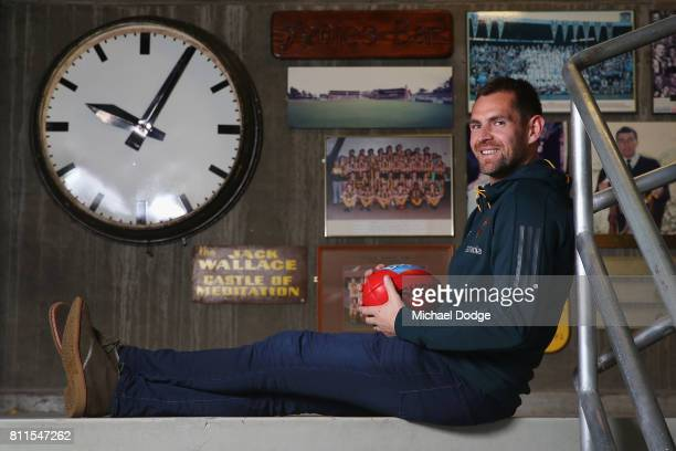 Luke Hodge poses after announcing his retirement on the eve of his 300th during a Hawthorn Hawks AFL press conference at Waverley Park on July 10...
