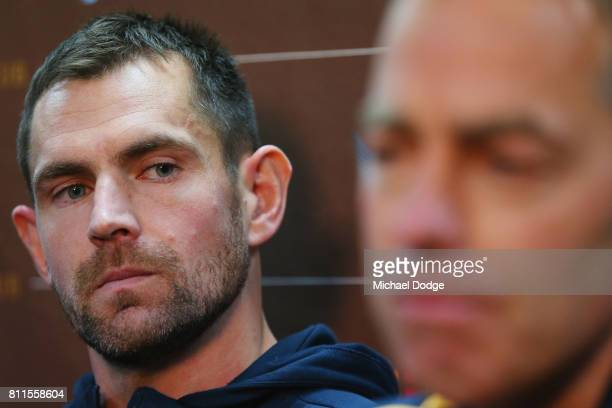 Luke Hodge reflects after announcing his retirement next to coach Alastair Clarkson on the eve of his 300th during a Hawthorn Hawks AFL press...