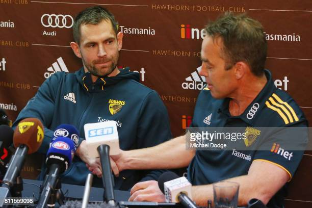 Luke Hodge shakes hands with coach Alastair Clarkson after announcing his retirement on the eve of his 300th during a Hawthorn Hawks AFL press...
