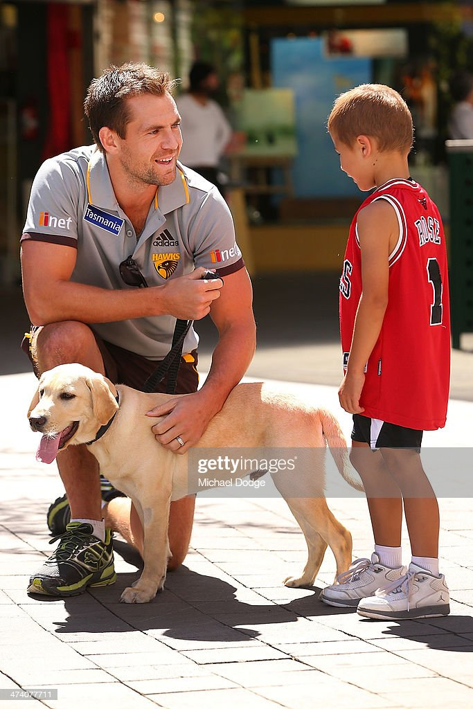 Luke Hodge talks to a young boy during Guide Dogs Tasmania 'Take the Lead' campaign launch during the Hawthorn Hawks AFL Community Camp on February 22, 2014 in Launceston, Australia.