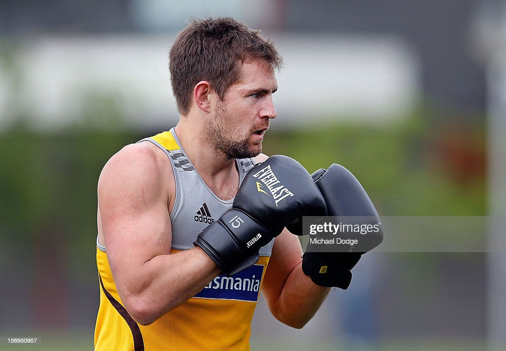 <a gi-track='captionPersonalityLinkClicked' href=/galleries/search?phrase=Luke+Hodge&family=editorial&specificpeople=241521 ng-click='$event.stopPropagation()'>Luke Hodge</a> wears boxing gloves during a Hawthorn Hawks pre-season AFL training session at Waverley Park on November 26, 2012 in Melbourne, Australia.