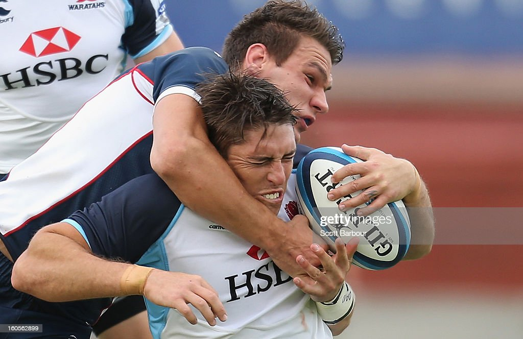 Luke Holmes of the Waratahs is tackled during the Super Rugby trial match between the Waratahs and the Rebels at North Hobart Stadium on February 2, 2013 in Hobart, Australia.